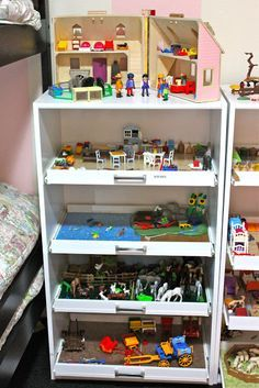 Playmobil organization - rolling shelves.  Could use this with all the Playmobil we have in the attic.