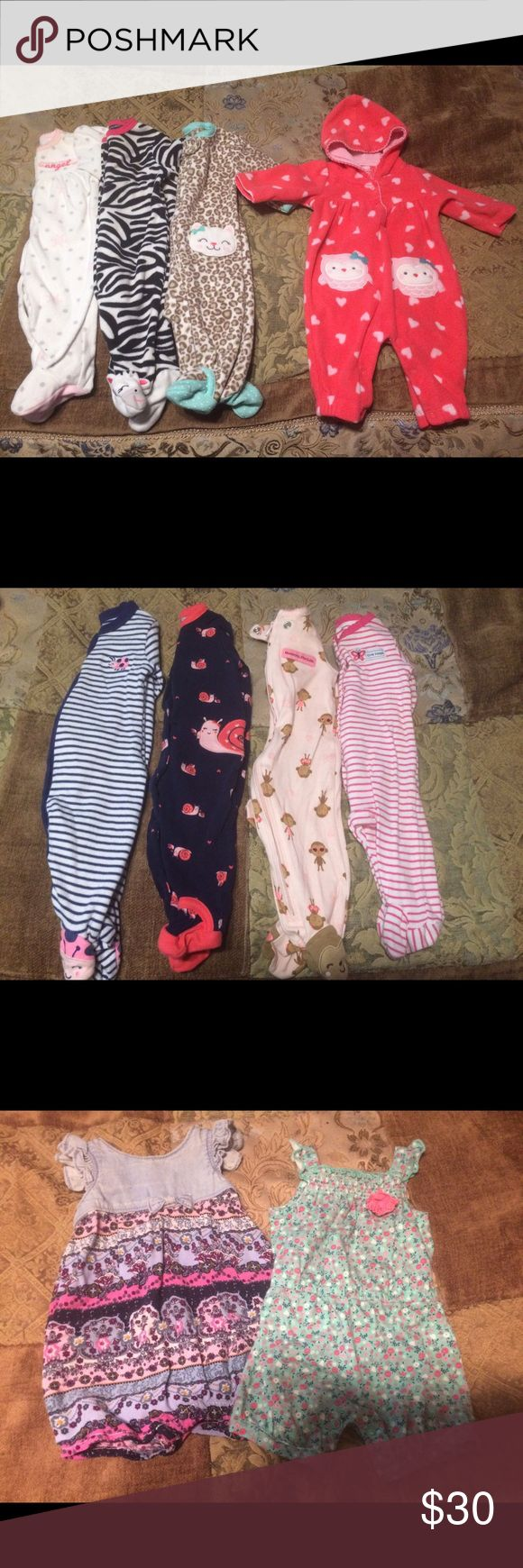 Newborn 0-3 month lot . More shown in pics! 4 fleece newborn sleepers, one has a good and no feet. 4 lightweight sleepers. 3 are button ups, one is zipper. 3 long sleeve newborn giraffe onesies. Brand new with tags. (Couldn't upload anymore pics if interested I'll upload) 2 0-3 month rompers 1 0-3 month purple tank top.  1 0-3 month sundress with diaper cover and reversible sun hat Sell as whole lot for $30 or 5$ per outfit/set One Pieces
