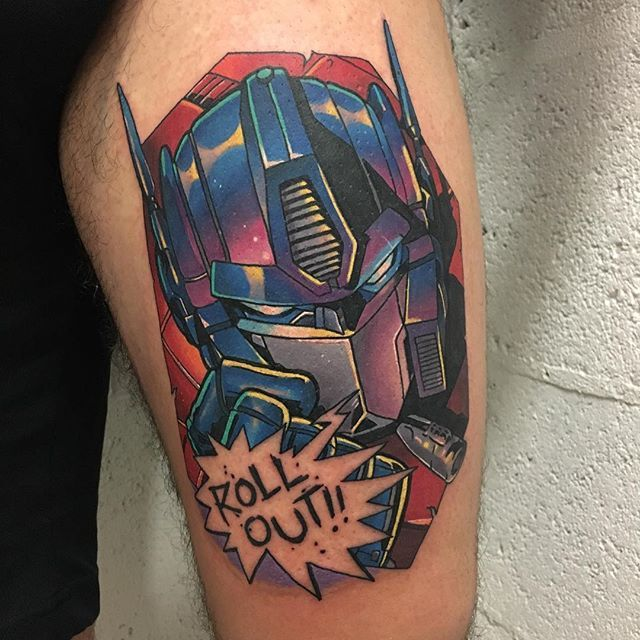 Autobots roll out! Optimus Prime tattoo by Andy Walker.