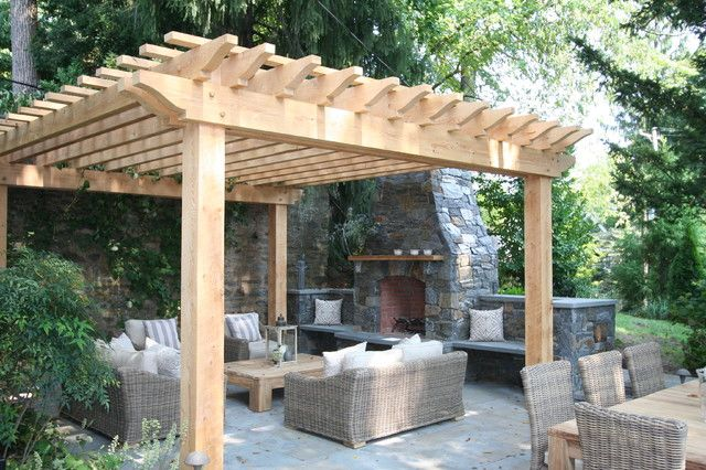Unique Pergola Design for Green Outdoor Living Space: Warm Small Wooden Pergola Idea With Open Roof To Cover Outdoor Rattan Lounge Set With Traditional Stone Framed Fireplace