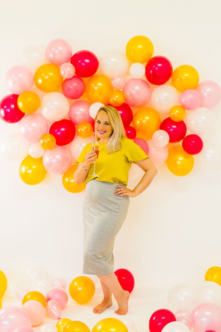 DIY balloon wall backdrop for New Years Eve celebrations and photo booths.