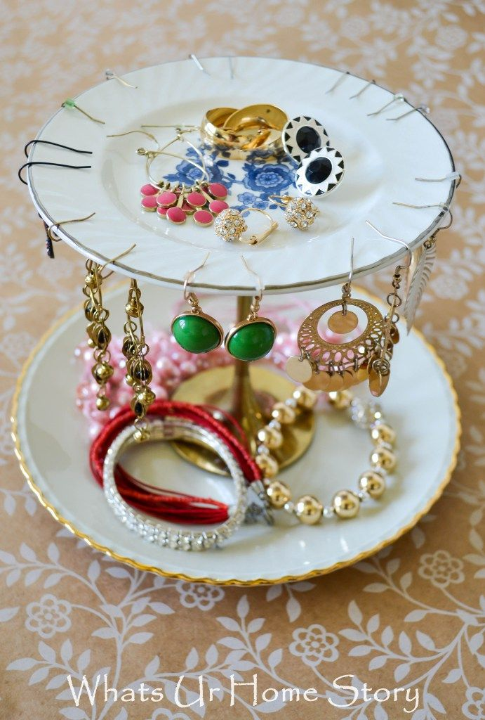 This tiered jewelry stand started out as 2 plates and a Brass candle stick from the thrift store! Tutorial at www.whatsurhomestory.com