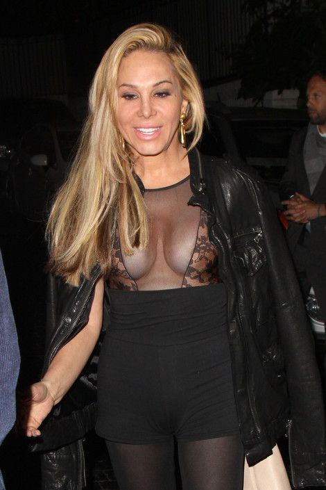 Adrienne Maloof practically falling out of a sheer black dress. Clearly, should have zipped up that leather jacket!