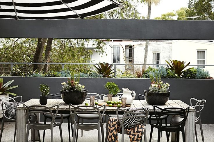A mix of gray and black outdoor chairs