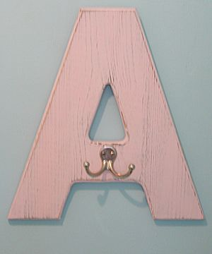 Letter hooks with each kid's initial for the bathroom. Great idea.
