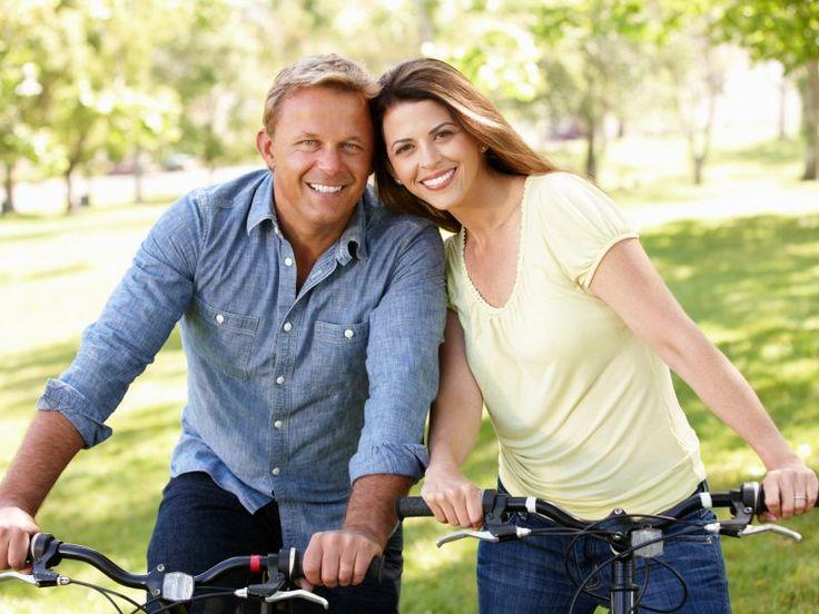 Happy mature couple riding bikes