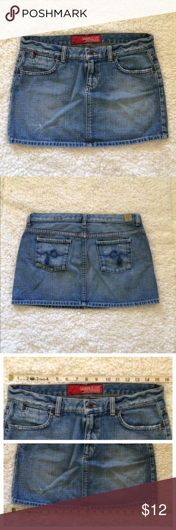 "Guess Jeans Denim Mini Skirt Size 28 Cute jean mini skirt in good used condition. Some frayed/distressed areas as shown in pictures. Waist: 15-1/2"". Length: 13-3/4"". Measurements are approximate. Guess Skirts Mini"