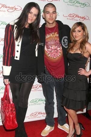 Khloe Kardashian with Robert Kardashian Jr. and Adrienne Bailon at the Ed Hardy Holiday Party. Ed Hardy Store, Hollywood, CA. 12-14-07