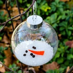 This melted snowman ornament was easy to make using a clear plastic ornament and some household products.