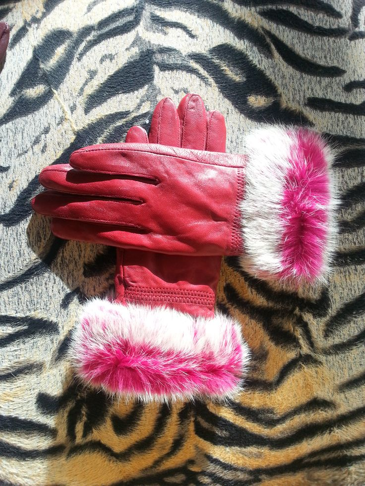 A selection of leather gloves with insulated lining for warmth and comfort.  Edged in two tone rabbit fur.  Small and medium sizes available in a variety of colours.   Contact:  wolffboutiquefashion@gmail.com
