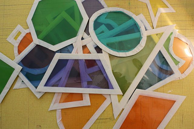 Awesome DIY light table toys - cut up colored dividers ($2 per package at K-mart) into shapes & line the borders with masking tape