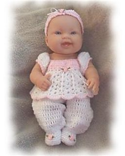 This is a crochet pattern for an adorable romper set. The instructions are for the footie pants, the top, and headband.