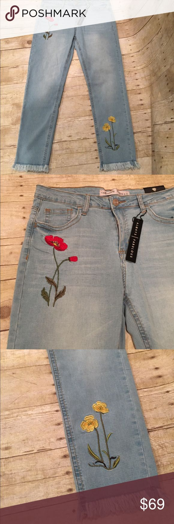 Absolutely adorable flowered tattered jeans NWT 12 Adorable light denim jeans size 12. NWT worn to the ankle Jeans Ankle & Cropped