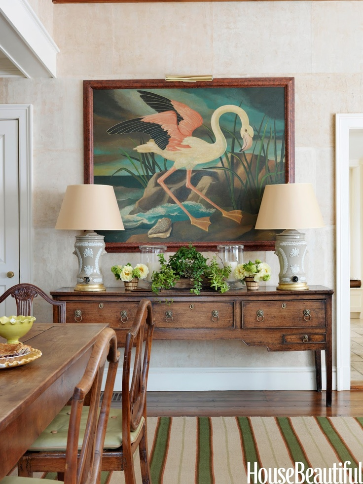 """The flamingo, painted by British artist William Skilling, """"is fun,"""" Newberry says.   It hangs over an 18th century Welsh dresser. Custom carpet by Beauvais.  All images courtesy of House Beautiful.  Article: Produced by David M. Murphy Styled by Gregory Bissonnette  Interior design by Connie Newberry Interview by Christine Pittel Photographs by Jonny Valiant"""