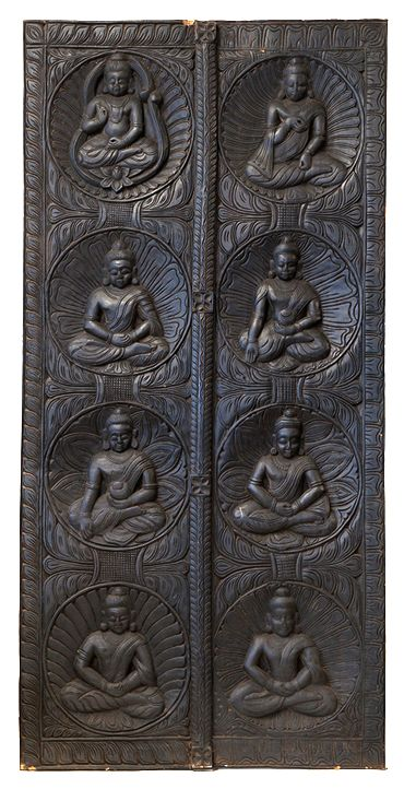 Eight carved Buddhas decorate this wooden door panel. Buy from http://bringingitallbackhome.co.uk/shop/eight-buddha-statue-panel/