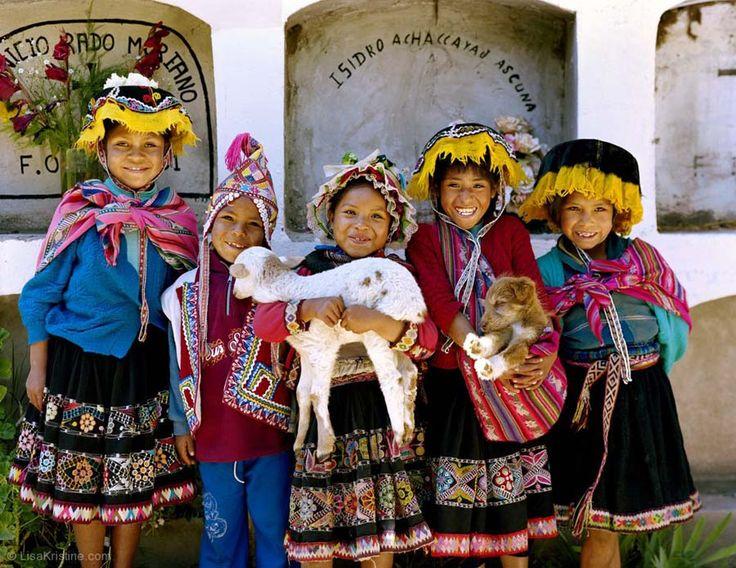 LOS NINOS, PERU  Children in Cuzco holding a small goat.  CONTACT ART REPRESENTATIVE  707-938-3860