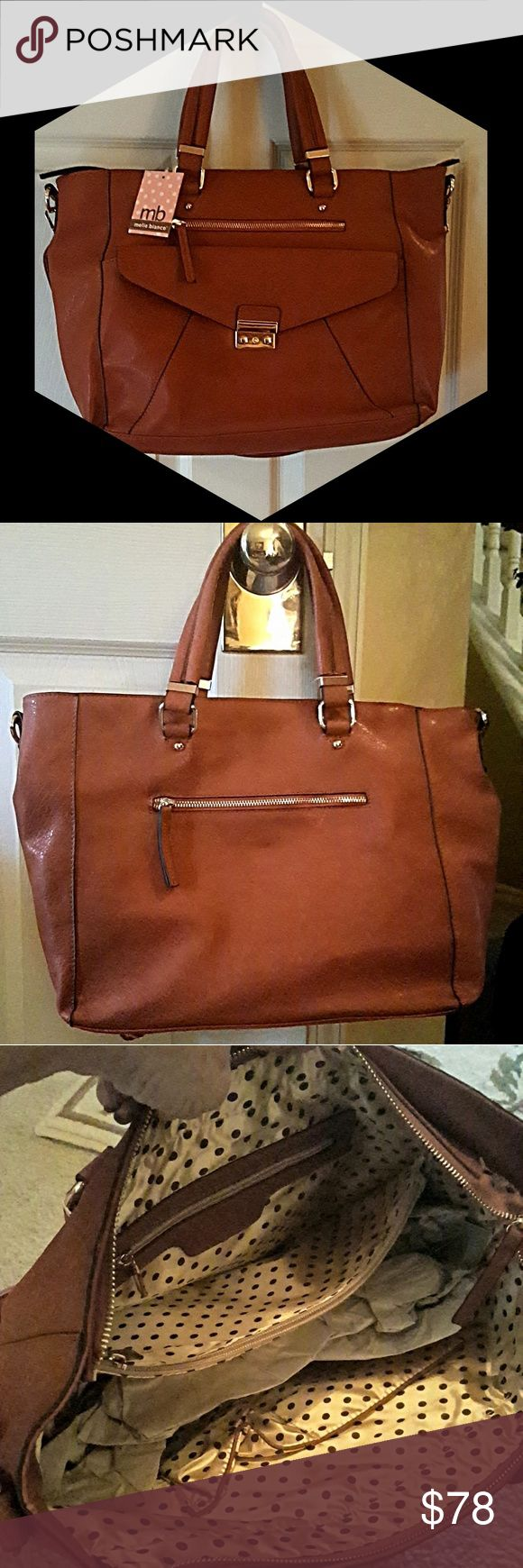 """EXTRA LARGE COGNAC VEGAN TOTE WOW! This bag is just fabulous for the Working Girl and/or the new Mom! It can be worn as a satchel or shoulder bag w/ an adjustable 32"""" strap. Inside there are 2 multi-functional pockets, a middle zip large pocket, as well as a zip compartment along the back. Turn the bag around & there is another zip pocket on the rear. Tastefully done is a separate compartment in the front done in gold hardware for easy access. Melie Bianco Bags Totes"""