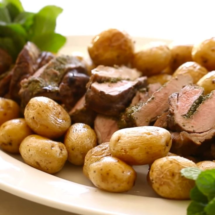One bite of this tender roasted lamb roulade with mint pesto served with roasted potatoes and you'll fall in love.