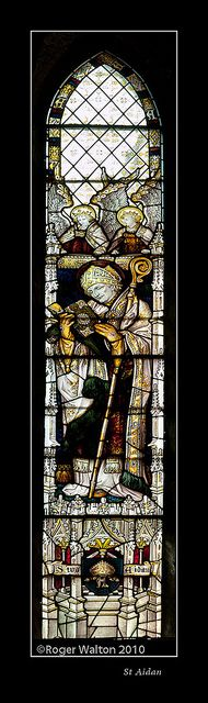 St Aidan.     		Chancel window at St Oswald's Church, Filey - by Powell Bros. of Leeds