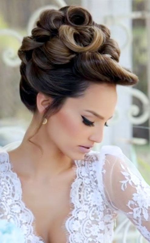 Bride's looped high bun updo bridal hair ideas Toni Kami Wedding Hairstyles ♥ ❷ Wedding hairstyle lovely makeup