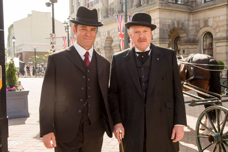 "Yannick Bisson (""Murdoch"") and Thomas Craig (""Brackenreid"") pose for the camera between scenes"