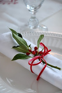 Simple red and white is perfect for a holiday table. Pyracantha or holly tucked under a red ribbon.