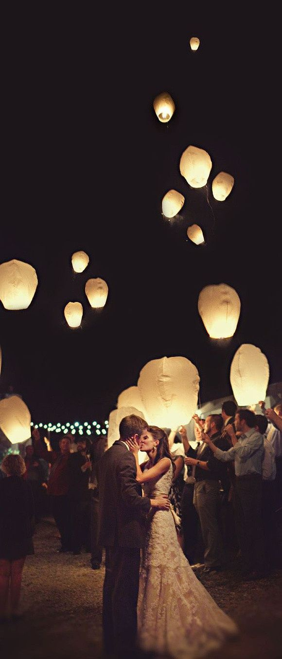 romantic couple with flying lanterns