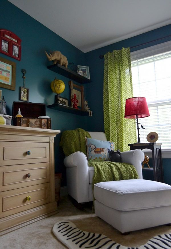 Love the colors of this nursery. Dark teal walls with bright green curtains.