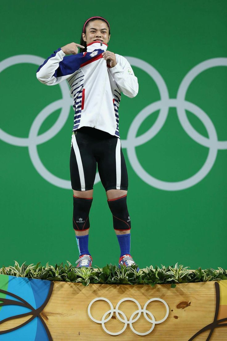 RIO DE JANEIRO, BRAZIL - AUGUST 07: Gold medalist, Shu-Ching Hsu of Chinese Taipei celebrates on the podium after the Women's 53kg Group A weightlifting contest on Day 2 of the Rio 2016 Olympic Games at Riocentro - Pavilion 2 on August 7, 2016 in Rio de Janeiro, Brazil. (Photo by Lars Baron/Getty Images)
