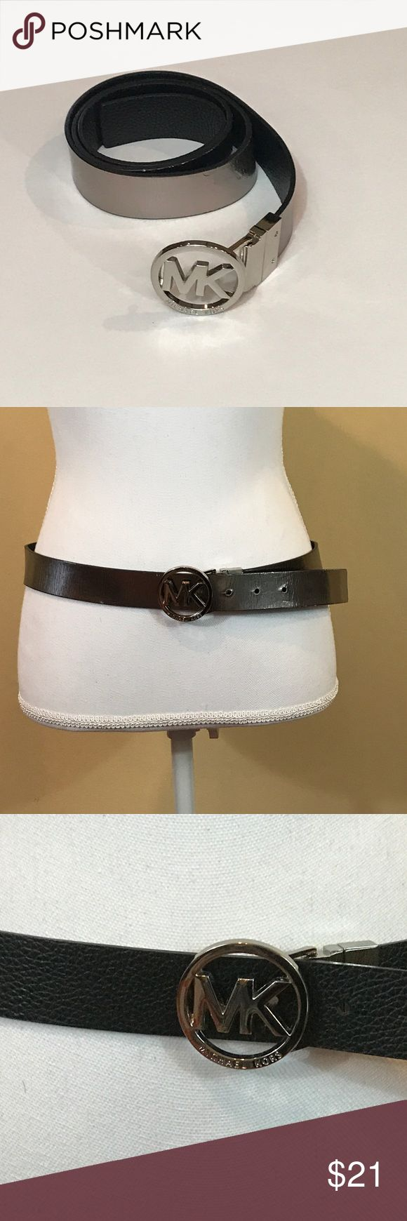 "Michael Kors 1 1/2 Inch Reversible Belt Michael Kors 1 1/2 Inch Reversible Belt Size Medium. The buckle pulls out and reverses for two different colors. One side is pebble black and the other side, gun metal. The leather without the buckle measure as approximately 38.5"". The buckle is approximately 1 3/4"" diameter. Michael Kors Accessories Belts"