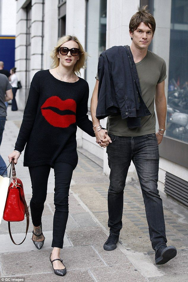 Birthday girl! Fearne Cotton steps out hand-in-hand with husband Jesse Wood for a leisurel...