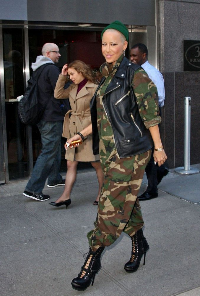 Model Amber Rose leaves Nick Cannon's radio show wearing army fatigues, a leather vest, and high heeled combat boots.