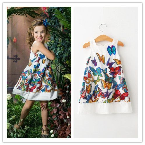 Gorgeous DKNY butterfly cotton dress.   Light flowing dress with layered petticoat style to back of dress - very funky and unique.   Bright coloured butterflies all over sleeveless dress.   This is a great addition for your daughters Spring and Summer wardrobe.