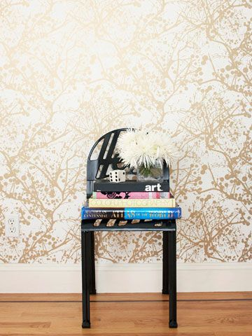 """Choosing paper with a metallic sheen adds glamour to the dining room. """"Wallpaper is much easier to hang and remove than it used t o be,"""" Coop says. """"It isn't intimidating and shouldn't be viewed as something too permanent. I change my wallpapers now and then just to refresh a room and change the vibe. It's the perfect way to reinvent a living space."""""""
