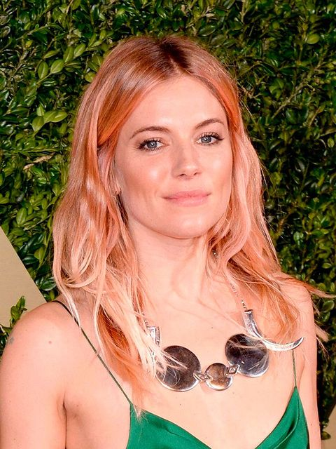 Sienna Miller's rose gold meets peach emoji tint basically broke the internet.