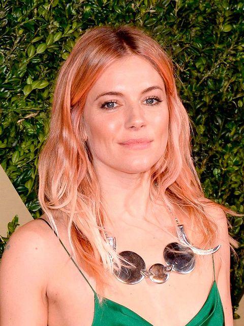 Sienna Miller's rose gold meets peach emoji tint basically broke the internet.