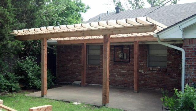 plastic tin roof | Cedar framed pergola with a clear fiberglass corrugated roof.