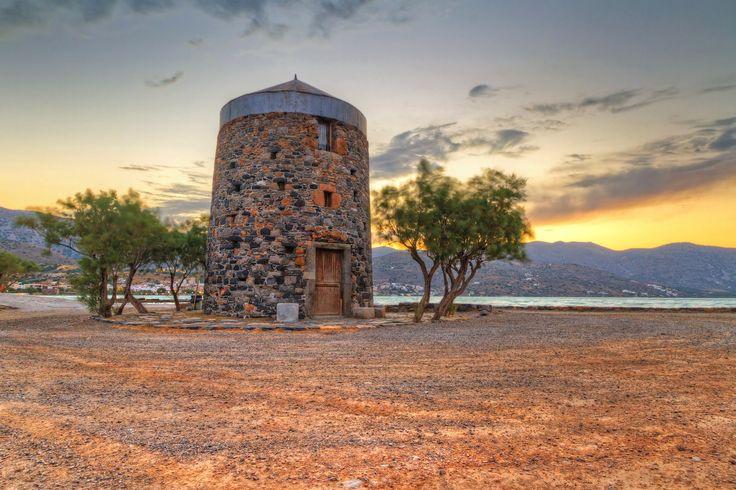 Windmill sunset background on Kythnos island