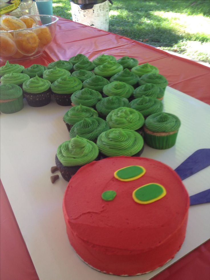 Very hungry caterpillar with the head as the smash cake for this little guys first birthday! From Sugar N' Things!