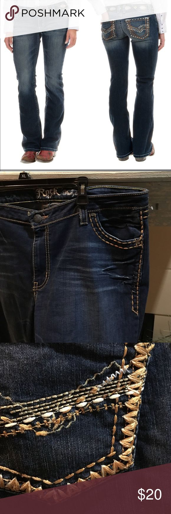 """Rock 47 ultra low rise jeans New with tags. Rock 47 by Wrangler. Ultra Low rise. Washed denim. very comfortable, touch of spandex to ease the fit and plenty of blingy details to jazz up cowgirl persona. Fabric is a lightly stretching cotton denim with stretch polyester. Five-pocket styling. Bootcut leg. Leg opening: 18"""". Waistband: 1"""". Belt loops: 2"""" Fabric: 92% cotton, 6% polyester, 2% spandex. When measured: 38"""" waist. 34"""" inseam. But Tag reads 34x32. Size guide online states equivalent to…"""
