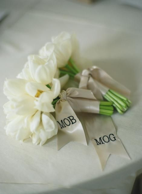 The mothers and grandmother will carry petite bouquets similar to this—but we will use blush garden roses, ivory ranunculus, and ivory spray roses and they will be wrapped in ivory ribbon with the stems showing