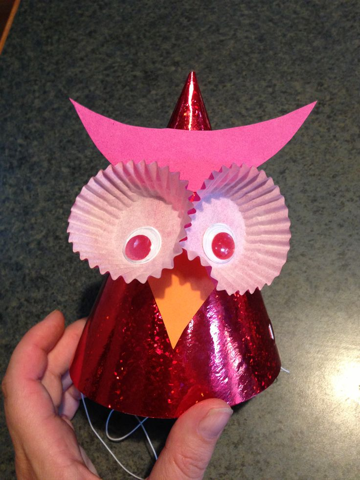 Owl Party Hat. You need party hats, googly eyes, cupcake liners, glue and coloured cardboard for the beak and 'ears'. I cut out the beak a few times and found the one that worked the best had a curved inverted V shape. This made the beak slot in and under the eyes best. Have fun, DIY Mum