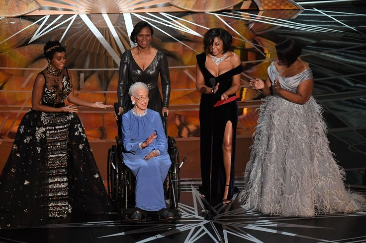 NASA physicist Katherine Johnson (C) is surrounded by US singer and actress Janelle Monae (L), US actress Taraji P. Henson (2ndR) and US actress Octavia Spencer (R) as they present on stage the Best Documentary Feature award at the 89th Oscars on February 26, 2017 in Hollywood, California. / AFP / Mark RALSTON        (Photo credit should read MARK RALSTON/AFP/Getty Images)