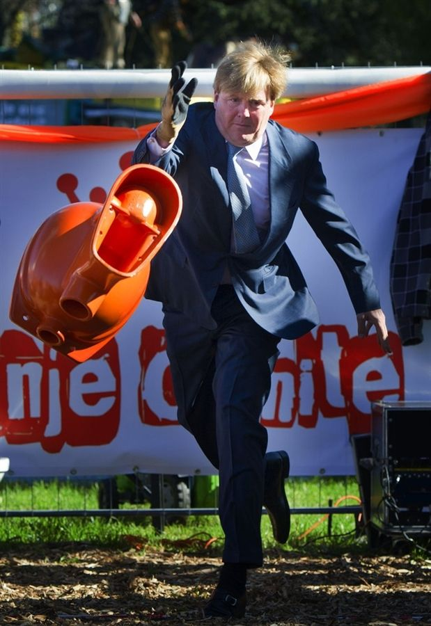 Dutch prince takes part in toilet-bowl-tossing contest at queensday in Rhenen, Holland