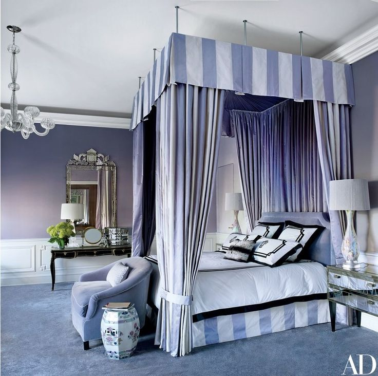 Anchoring the master suite is a bed by Anthony Lawrence-Belfair with a canopy and curtains of a Manuel Canovas silk stripe and custom-made bedding by Susan Shepherd Interiors | archdigest.com