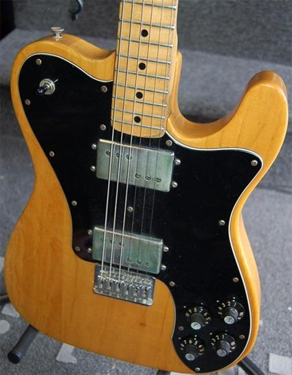 1972 Fender Tele Deluxe, butterscotch blonde finish, hardtail. The Tele Deluxe features two Fender Wide Range humbuckers, designed by Seth Lover, inventor of the original PAF humbucker. The Wide Range HBs differ from most HBs by having rod magnets in the coils rather than a bar magnet sitting underneath them.