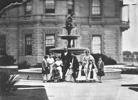 Queen Victoria and Prince Alfred with their children outside Osborne House, 1854