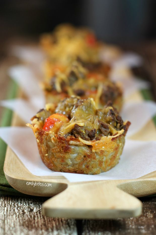 Cheeseburger Hash Brown Cups: a perfect cup that's crispy on the outside and soft and potato-ey on the inside piled high with seasoned ground beef, ketchup, mustard and tomatoes and topped with melty cheddar cheese. Sound sinful? One of these tasty and filling cups is a mere 131 calories and only 3 Weight Watchers Points Plus!