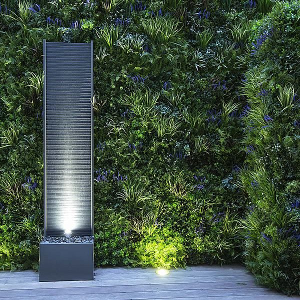 Kensington Courtyard Garden design, living green walls, illuminated with garden lighting in this limited space, Vestra limestone slab