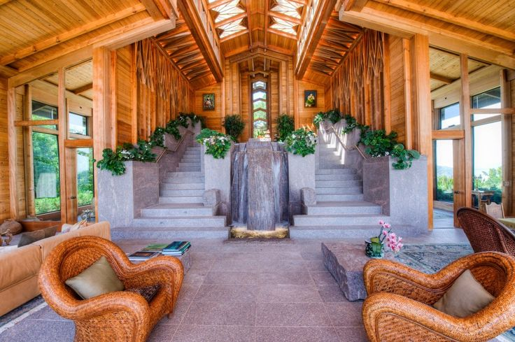 Indoor Fountains Design Ideas for Interior Decor Your Home : Eclectic Living Room With Built In Planters Plus Concrete Stairs Also Double Staircase And Indoor Fountains In Glass House With Redwood Plus Skylight And Tall Ceilings Also Wicker Armchair